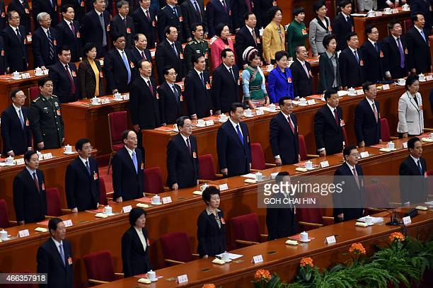 Chinese leaders sing the national anthem during the closing of the 3rd Session of the 12th National People's Congress at the Great Hall of the People...