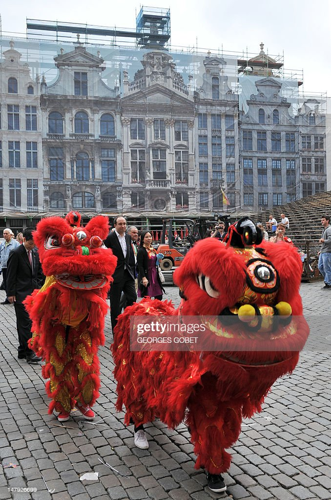Chinese lions open the way on July 6, 2012 on the Grand Place in Brussels to Belgian and Chinese personalities, heading to attend a ceremony at the nearby famous Manneken-Pis fountain. The bronze boy that pees into a fountain was dressed for the first time on July 6 in a traditional Hong Kong costume, including a Zhongshan suit and a clipboard under his arm.