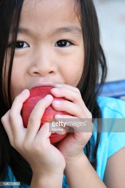 Chinese little girl eating apple