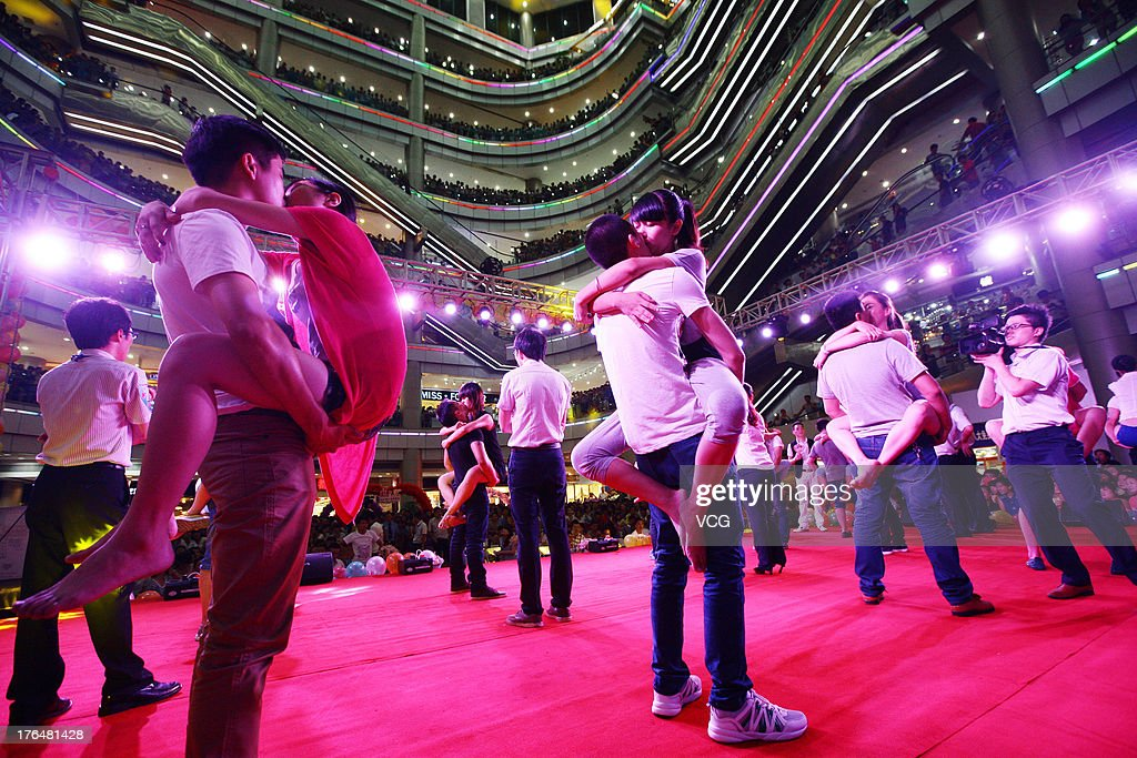 Chinese lovers kiss during a competition to greet the Chinese Valentine's Day on August 13, 2013 in Quanzhou, China. The Chinese Valentine's Day falls on the 7th day of the 7th month on the Chinese lunar calendar which falls on August 13 this year.