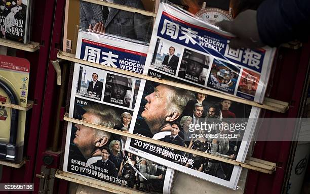 A Chinese magazine featuring US Presidentelect Donald Trump on the cover is seen at a newsstand in Shanghai on December 14 2016 China warned Taiwan...