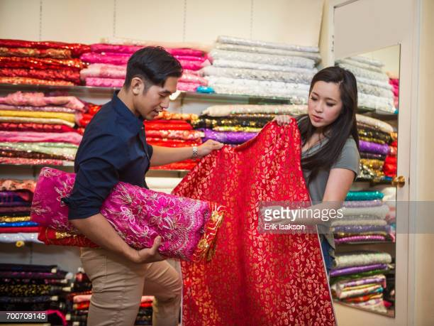 Chinese man and woman shopping for fabric