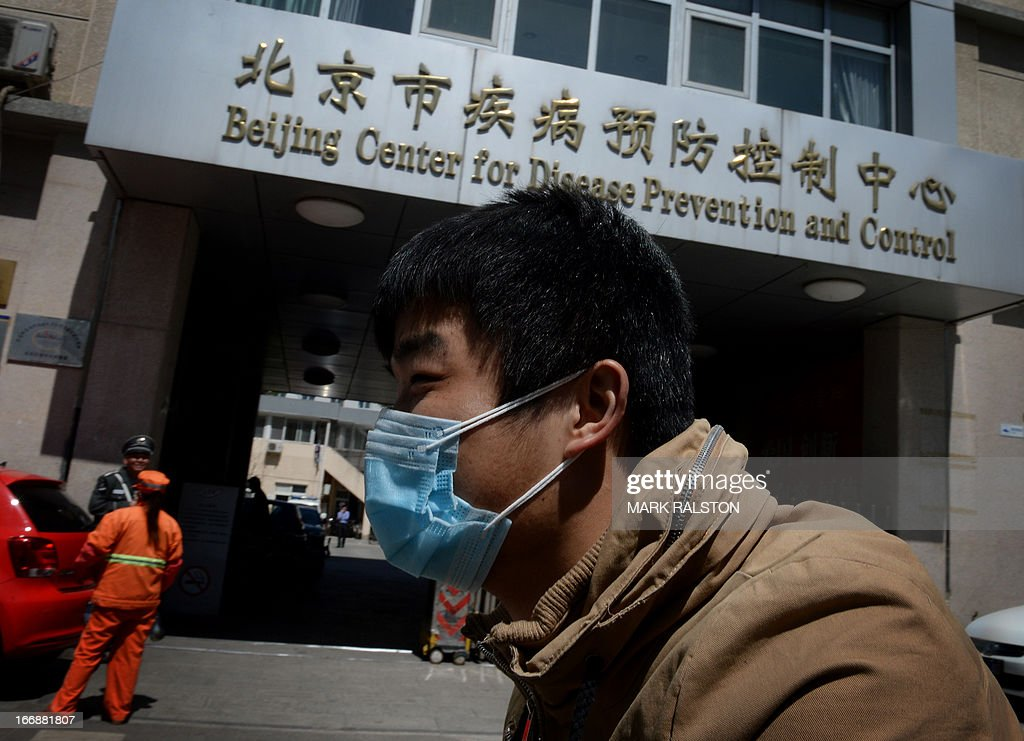 A Chinese man arrives at the Beijing Center for Disease Prevention and Control as the country deals with the H7N9 bird flu virus on April 18, 2013. China has confirmed a total of 82 human cases of H7N9 avian influenza since announcing about two weeks ago that it had found the strain in people for the first time. Health authorities in China say they do not know exactly how the virus is spreading, but it is believed to be crossing to humans from birds, triggering mass poultry culls in several cities. AFP PHOTO/Mark RALSTON