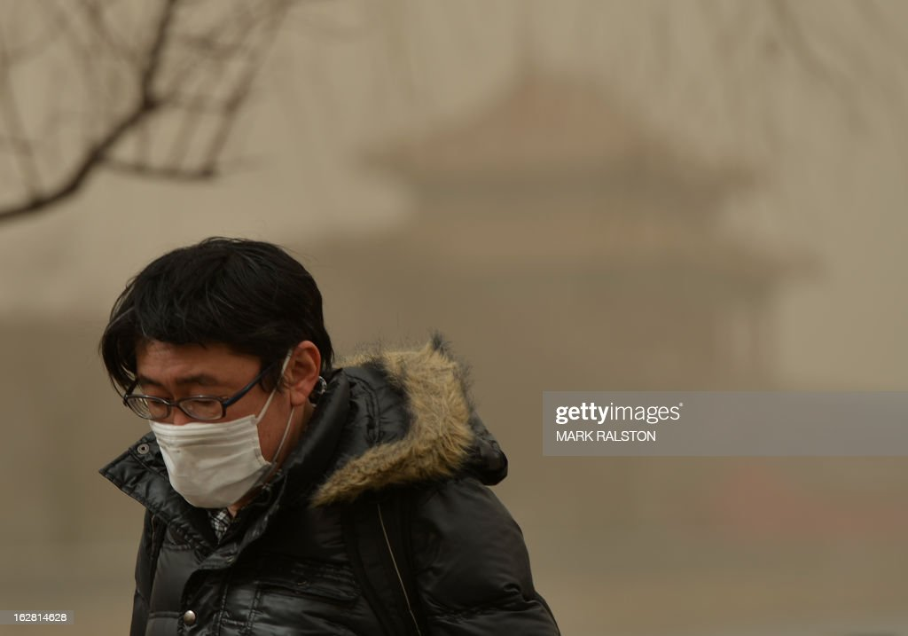 A Chinese man covers his nose as Beijing is hit by a sandstorm as well as air quality worse than the highest classification of 'hazardous' on February 28, 2013. State media reported that Beijing air pollution levels reached extremely hazardous levels for the second time this week as citizens struggled to protect themselves from the two-pronged hazards of dust and pollution. AFP PHOTO/Mark RALSTON