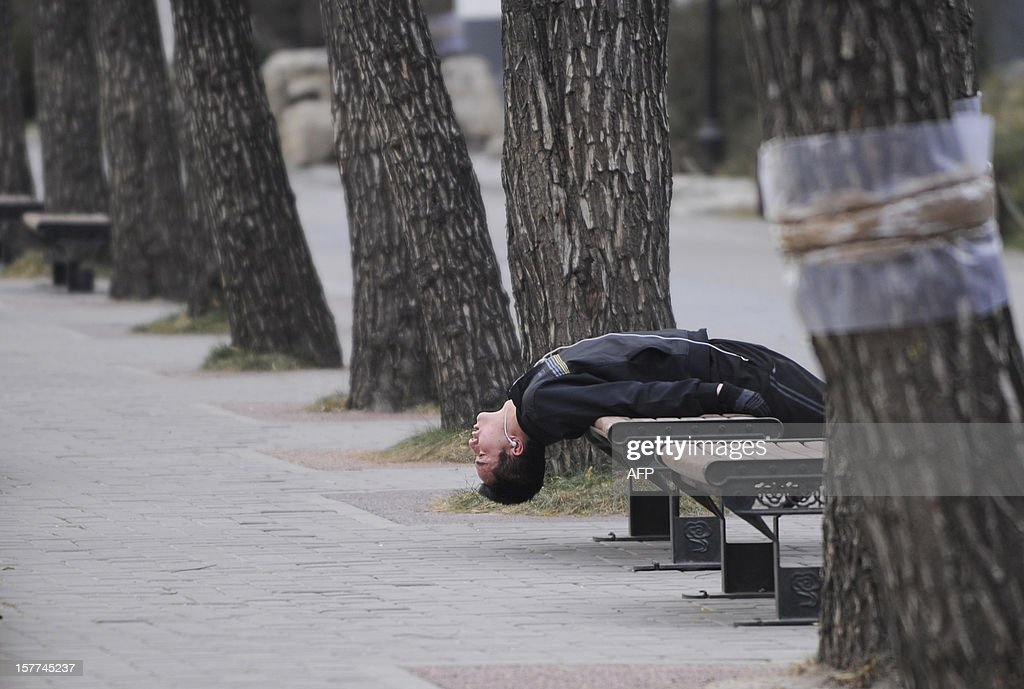 A Chinese man does exercise on a bench in Beijing on December 6, 2012. China will allow transit passengers from 45 countries including the US, Canada and all members of the EU to spend up to 72 hours in Beijing without a visa from January 2013, city authorities said.