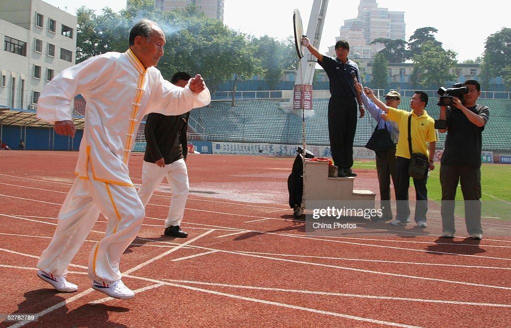 Chinese man Guo Cairu, 105-years-old, gets off the mark during an activity in which he challenges the 100 meter run record for centenarians on May 10, 2005 in Nanjing of Jiangsu Province, China. Guo finished in a time of 35.24 seconds though failed to break the record of 30.86 seconds set by 100-year-old South African Philip Rabinowitz last year. Guo stated that he will challenge the record again.