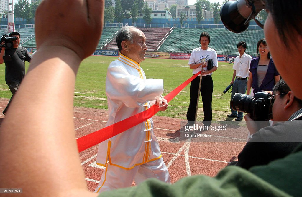 Chinese man Guo Cairu 105yearsold sprints during an activity in which he challenges the 100 meter run record for centenarians on May 10 2005 in...