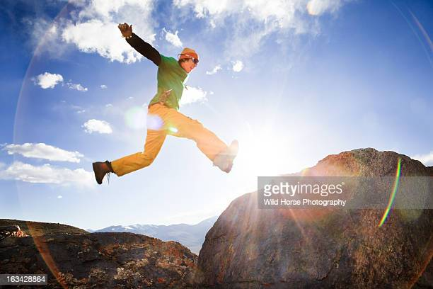 Chinese man jumping in the sky