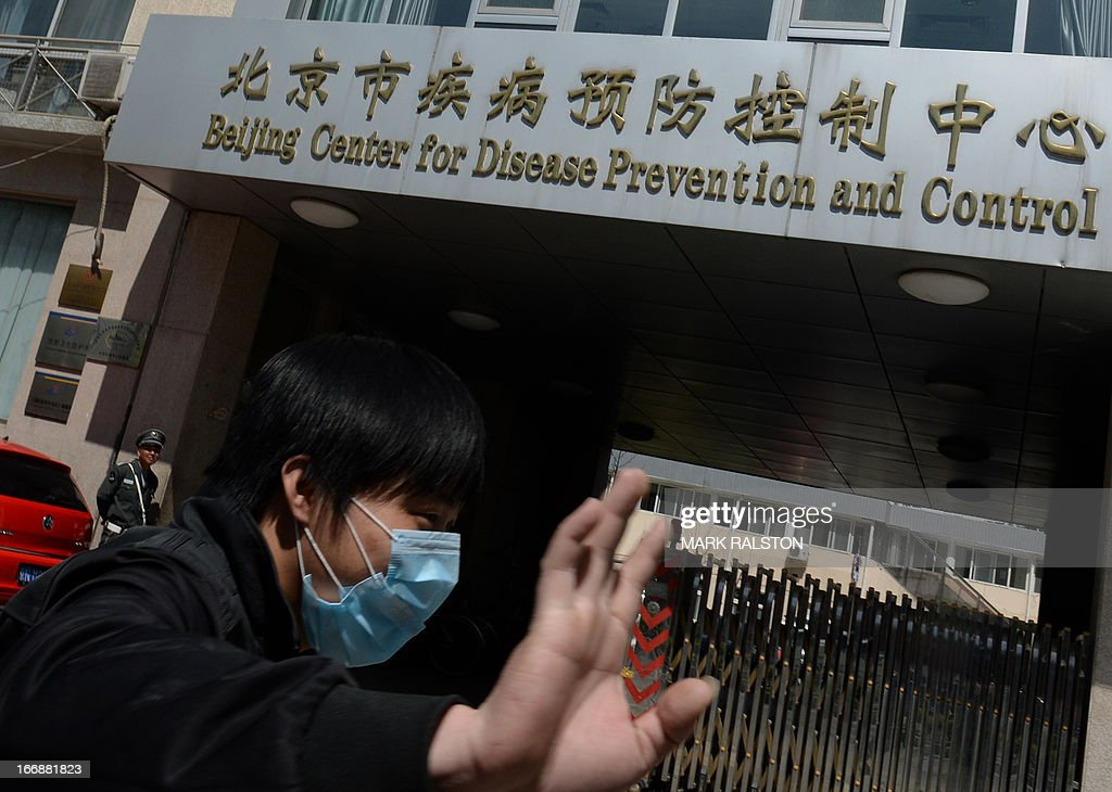 A Chinese man leaves the Beijing Center for Disease Prevention and Control as the country deals with the H7N9 bird flu virus on April 18, 2013. China has confirmed a total of 82 human cases of H7N9 avian influenza since announcing about two weeks ago that it had found the strain in people for the first time. Health authorities in China say they do not know exactly how the virus is spreading, but it is believed to be crossing to humans from birds, triggering mass poultry culls in several cities. AFP PHOTO/Mark RALSTON