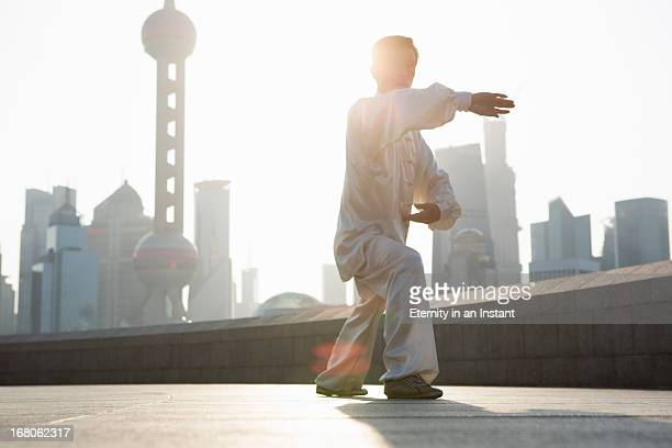 Chinese man practicing Tai Chi in the morning