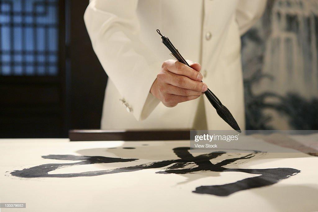 Chinese Man Practising Calligraphy