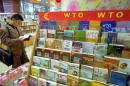 Chinese man reads a book from a World Trade Organization bookstand November 5 2001 in a bookshop in Beijing China China will join the freemarket WTO...