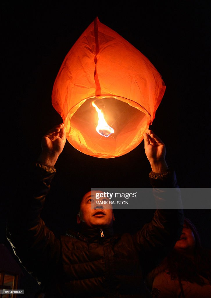 A Chinese man releases a paper lantern into the sky on the eve of the traditional Lantern Festival which falls on the 15th day of the Lunar New Year and officially ends the celebrations, in Yuxian on February 23, 2013. The festival which dates back more than 2000 years to the Han Dynasty sees China's cities become a sea of lanterns and fireworks. AFP PHOTO/Mark RALSTON