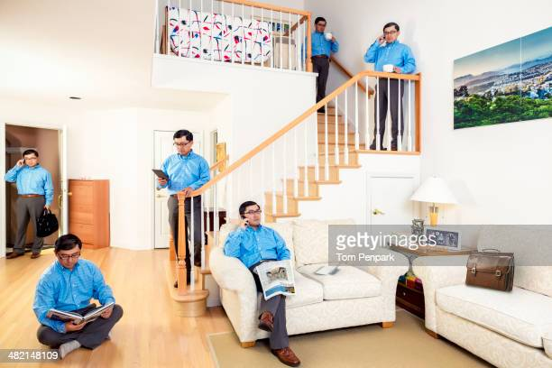 Chinese man sitting all over house