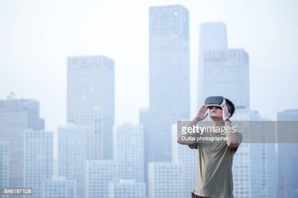 chinese man using the virtual reality headset