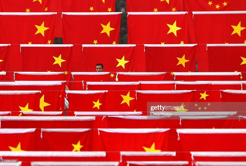 A Chinese man visits a national flag show at Chaoyang park September 30, 2006 in Beijing, China. Chinese people are preparing for National Day Celebration, the 57th anniversary of the founding of People's Republic of China which falls on October 1.