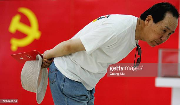 Chinese man visits an exhibition promoting Chinese Communist Party on June 15 2005 in Beijing China A senior official of the Communist Party of China...