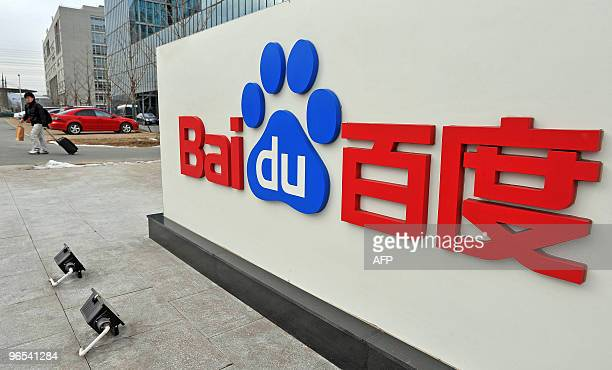 A Chinese man walks past the Chinese Web search giant Baidu's headoffice in Beijing on February 10 2010 The Nasdaqlisted Baidu said net profit rose...