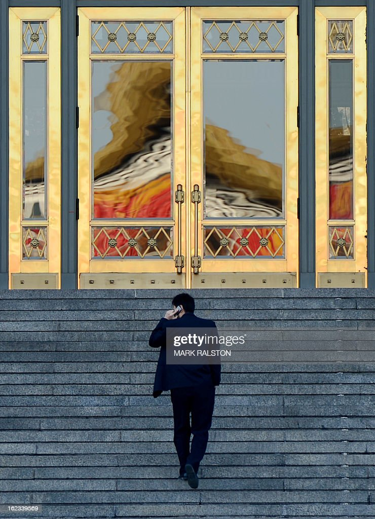A Chinese man walks up to the doors of China's parliament building known locally as 'The Great Hall of the People' as the city prepares for news weeks legislature meetings, in Beijing on February 22, 2013. China has fixed March 5, 2013, as the date it will convene a key legislative session, state media reported Friday, with new Communist Party chief Xi Jingping set to become president during the two-week meeting. The announcement comes after the Communist Party in November chose current Vice President Xi to take over the reins of the ruling party from current President Hu Jintao. AFP PHOTO/Mark RALSTON