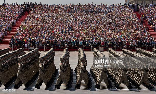 Chinese march in formation past Tiananmen Square and the Forbidden City during a military parade on September 3 2015 in Beijing China China is...