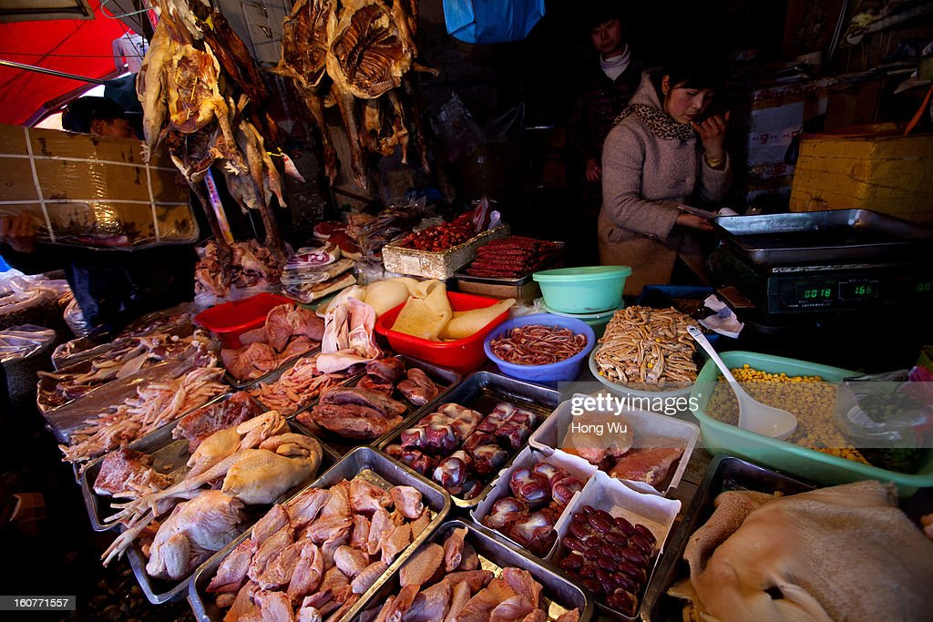 Chinese meat vendors wait for customers at an outdoor market on February 5, 2013 in Shanghai, China. Chinese citizens are stocking up on food ahead of the upcoming Chinese Lunar New Year, also known as Spring Festival, is one of the most important festivals in China and falls this year on February 10, 2013.