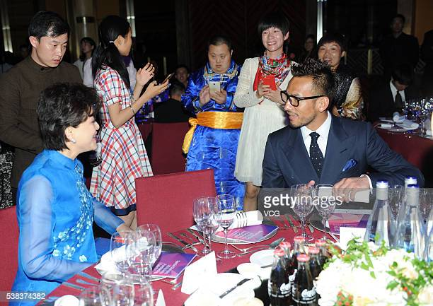 Chinese media proprietor and host Yang Lan talks with retired Japanese Football Player Hidetoshi Nakata during the Special Olympics 2016 Unity...