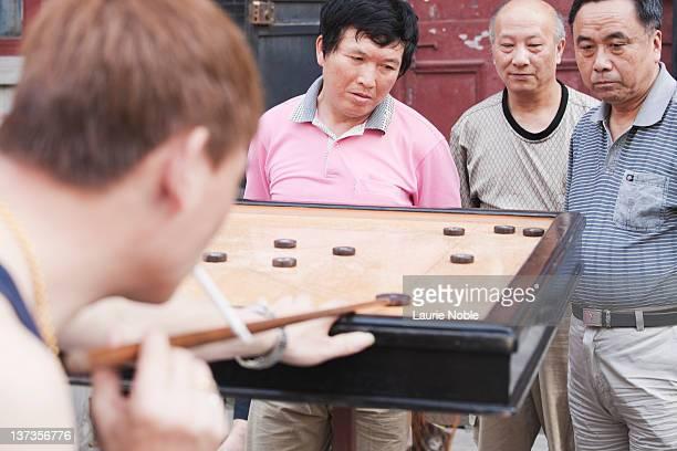Chinese men playing Carrom; Hongkou