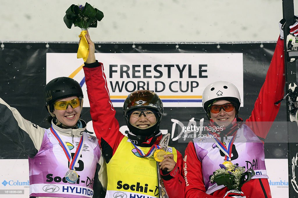 Chinese Mengtao Xu (C),Australian Laura Peel (L) and Swiss Tanja Schaerer pose on podium after the Ladies' FreeStyle Aerials final race at the Snowboarding and Free Style World Cup Test Event at the Snowboard and Free Style Centre in Rosa Khutor near the Russian Black Sea resort of Sochi on February 17, 2013. Chinese Mengtao Xu won the race ahead of Australian Laura Peel and Swiss Tanja Schaerer. AFP PHOTO / JAVIER SORIANO
