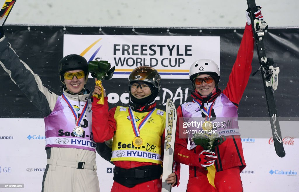 Chinese Mengtao Xu (C),Australian Laura Peel (L) andSwiss Tanja Schaerer pose on podium after the Ladies' FreeStyle Aerials final race at the Snowboarding and Free Style World Cup Test Event at the Snowboard and Free Style Centre in Rosa Khutor near the Russian Black Sea resort of Sochi on February 17, 2013. Chinese Mengtao Xu won the race ahead of Australian Laura Peel and Swiss Tanja Schaerer.