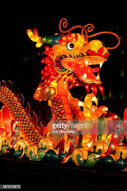 Chinese midautumn harvest festival is celebrated by lighting lanterns and eating moon cakes