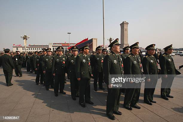 Chinese military delegates arrive at The Great Hall Of The People before the third plenary meeting of the National People's Congress on March 9 2012...