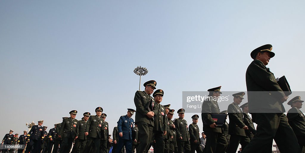 Chinese military delegates arrive at The Great Hall Of The People before the third plenary meeting of the National People's Congress (NPC) on March 9, 2012 in Beijing, China. Known as 'liang hui,' or 'two organizations', it consists of meetings of China's legislature, the National People's Congress (NPC), and its advisory auxiliary, the Chinese People's Political Consultative Conference (CPPCC).