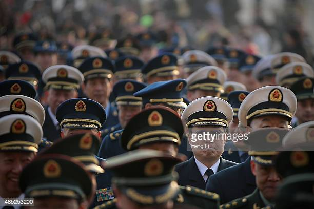 Chinese military delegates arrive at the Great Hall of the People before the opening session of the National People's Congress on March 5 2015 in...