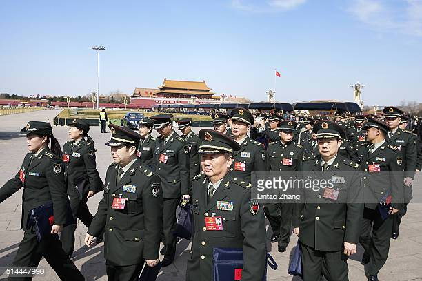 Chinese military delegates arrive at the Great Hall of the People before the 2nd plenary session of the National People's Congress on March 9 2016 in...