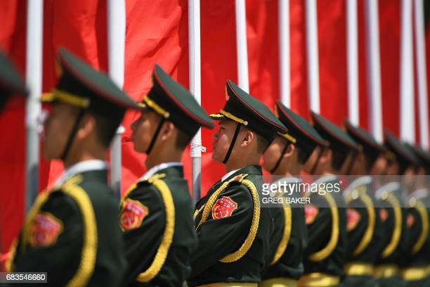 Chinese military flag bearers prepare for a welcome ceremony for Cambodia's Prime Minister Hun Sen outside the Great Hall of the People in Beijing on...