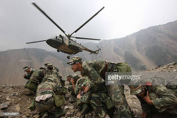 A Chinese military helicopter arrives to evacuate troops from the quakeinduced Tangjiashan Lake in southwest China's Sichuan province on May 31 2008...