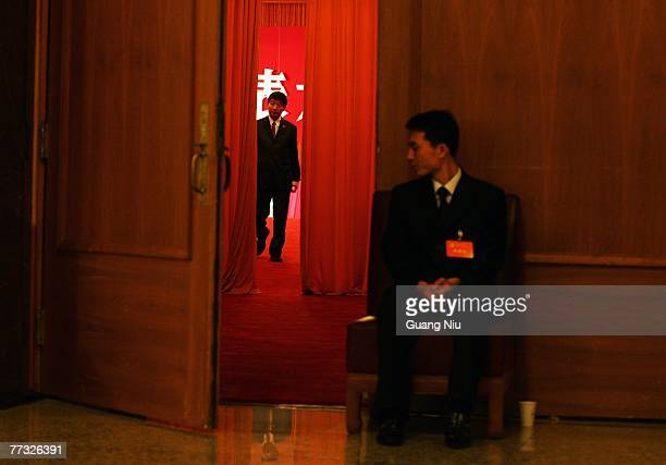 Chinese military officer guards during the opening session of the fiveyearly Chinese Communist Party Congress at the Great Hall of the People on...