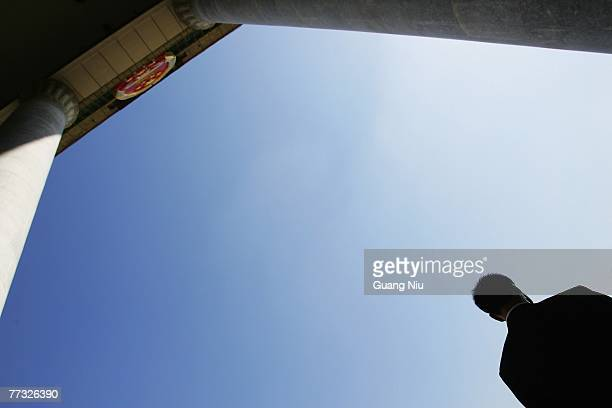 Chinese military officer guards outside of the Great Hall of the People during the opening session of the fiveyearly Chinese Communist Party Congress...