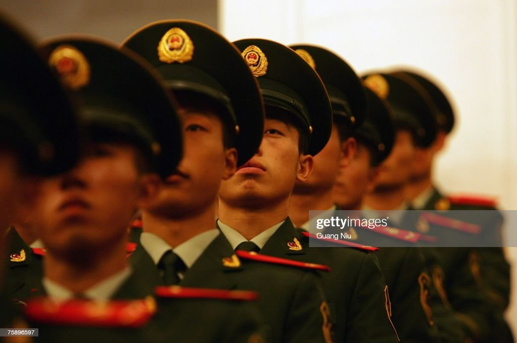 Chinese military officers with the new style military uniform attend a meeting at the Great Hall of the People to mark the 80th anniversary of the founding of the People's Liberation Army (PLA) on August 1, 2007 in Beijing, China. The PLA, the world's largest standing army with 2.3 million members, celebrates its 80th anniversary on August 1.