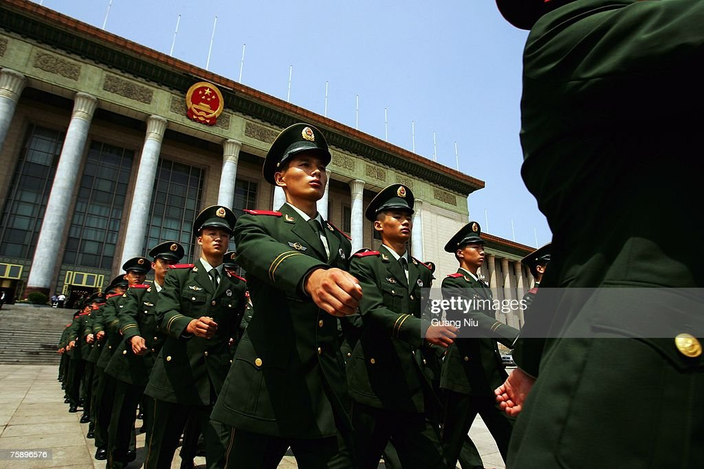Chinese military officers with the new style military uniform leave the Great Hall of the People after they attend a meeting to mark the 80th anniversary of the founding of the People's Liberation Army (PLA) on August 1, 2007 in Beijing, China. The PLA, the world's largest standing army with 2.3 million members, celebrates its 80th anniversary on August 1.