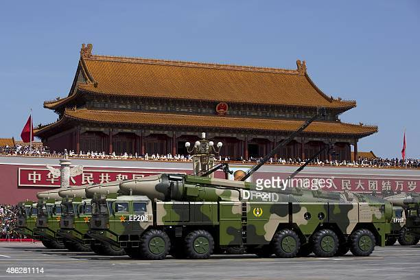 Chinese military vehicles carrying DF21D antiship ballistic missiles potentially capable of sinking a US Nimitzclass aircraft carrier in a single...