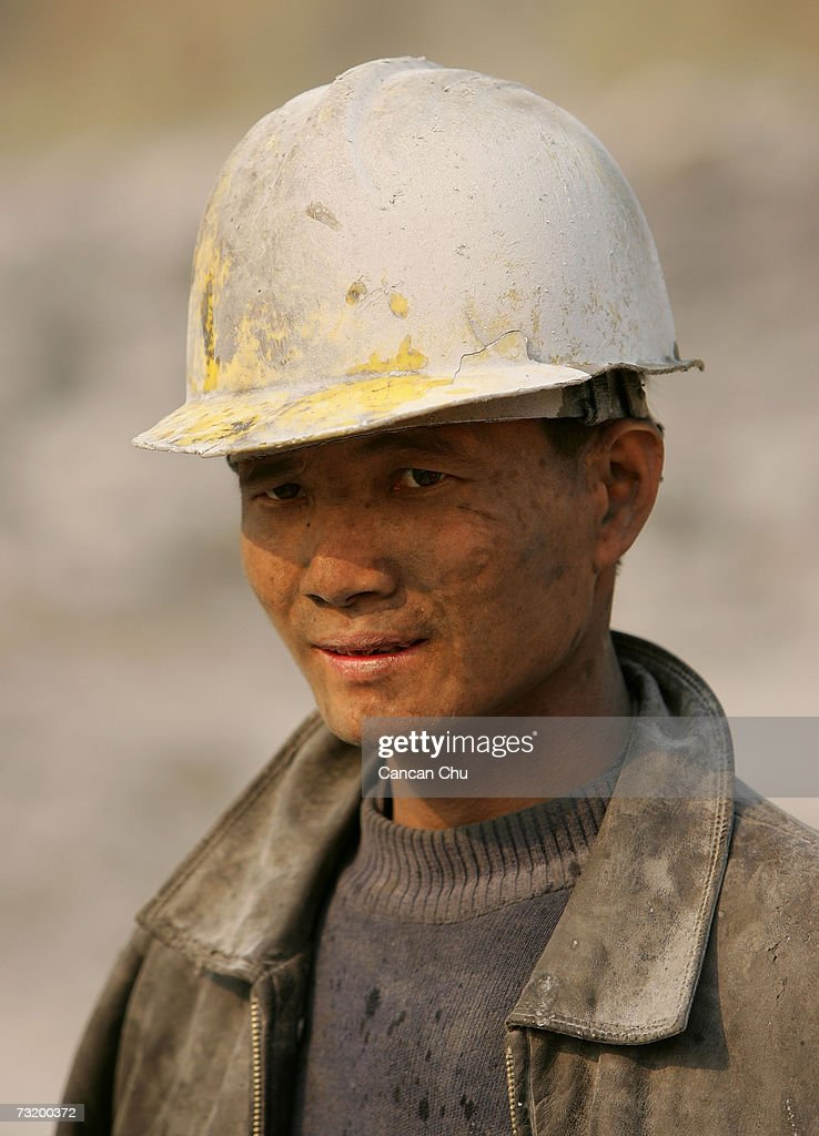 A Chinese miner works at a cement factory mine February 3, 2006 in Gaoming District, Foshan City, Guangdong Province of China. China will continue restructuring industries concerning coal, cement and aluminium and speed up eliminating backward production lines, technologies and products that involve high energy consumption, as China is exerting more efforts this year to save energy and reduce emission in every sector of the national economy, according to the National Development and Reform Commission.