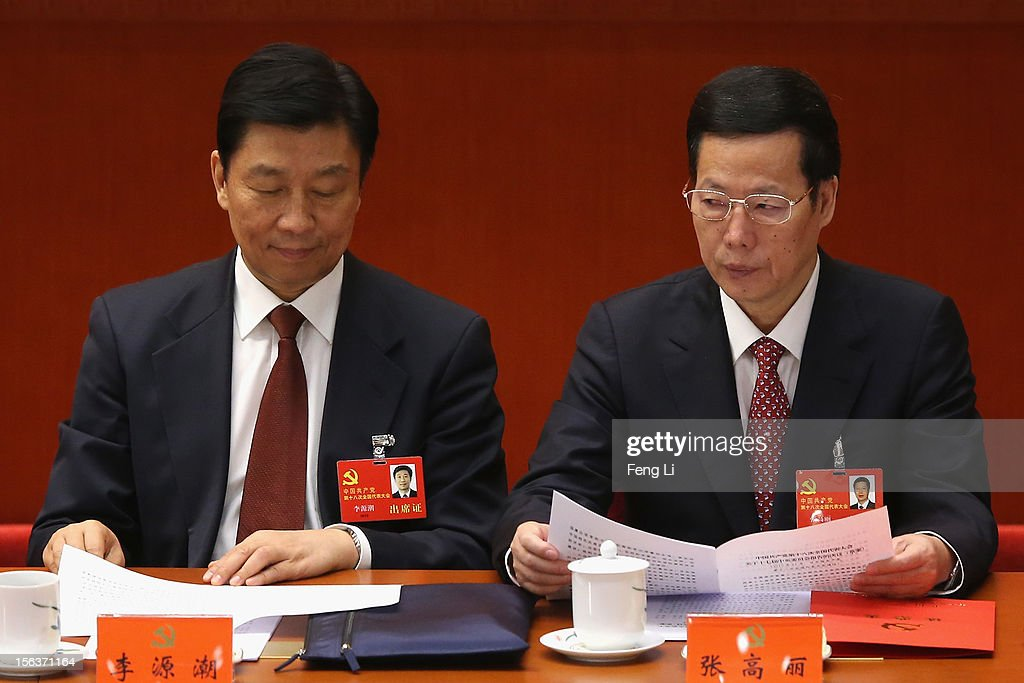 Chinese Minister of the Organisational Department Li Yuanchao (L) and Secretary of the CPC Tianjin Committee Zhang Gaoli (R) attend the closing session of the 18th National Congress of the Communist Party of China (CPC) at the Great Hall of the People on November 14, 2012 in Beijing, China. Members of the Standing Committee of the Political Bureau of the new CPC Central Committee will meet with journalists on November 15, 2012.