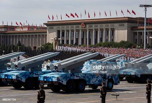 Chinese missiles are seen on trucks as they drive next to Tiananmen Square and the Great Hall of the People during a military parade on September 3...