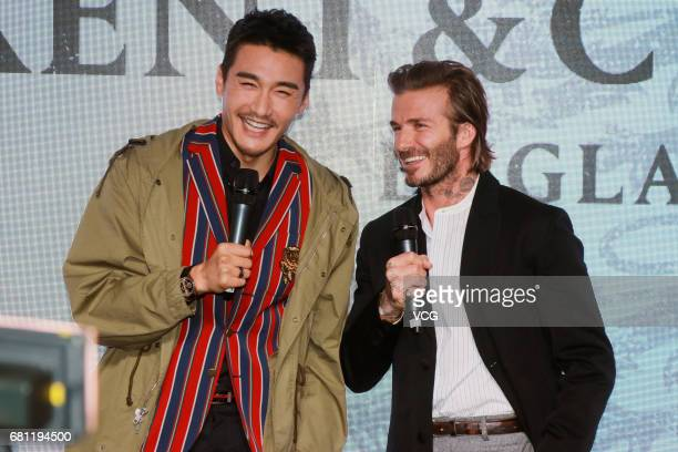 Chinese model and actor Hu Bing and English former footballer David Beckham attend Kent Curwen activity on May 9 2017 in Shanghai China
