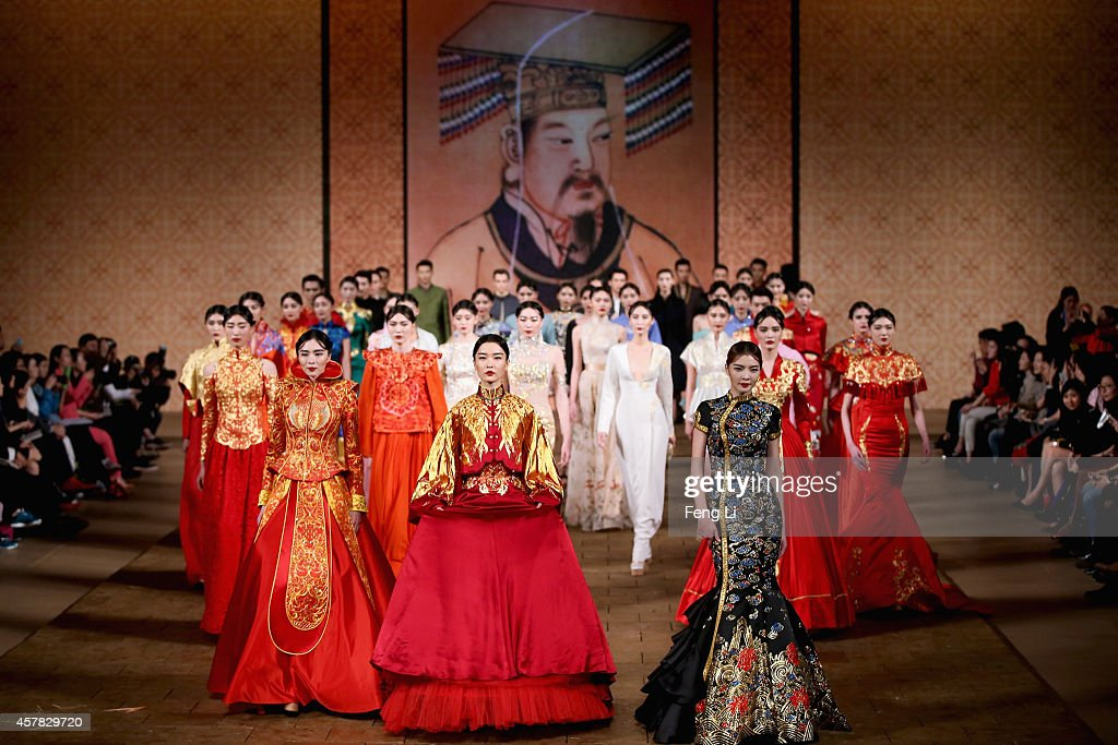 Chinese model and actress Jennifer showcases designs by Zhang Zhifeng on the runway at 2015 NETIGER Haute Couture Collection show during MercedesBenz...