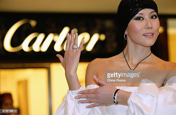 cartier singapore outlets ilqt  A Chinese model displays Cartier jewels at a store opening ceremony on  December 18 2004 in