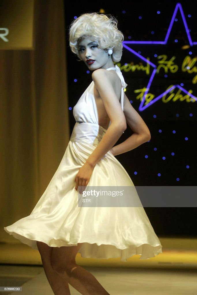 A Chinese model dresses up as a Marilyn Monroe look-a-like, during a contest organised by a cosmetic company in Beijing, 23 April 2005. Beauty contests have long been ridiculed and attacked in the West as degrading, but in China where anything from the West is synonymous with progress, they represent freedom and openness for a population that for decades lived under the iron grip of communist ideology, which saw beauty contests as bourgeois and decadent, people regard their return as another sign of the country's loosening of social controls and waning political interference. AFP PHOTO