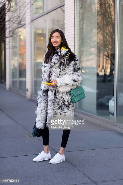Chinese Model exits the Jason Wu show at Spring Studios with a Chanel bag and Nike sneakerson February 13 2015 in New York City