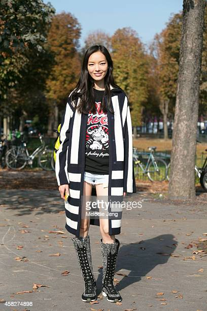Chinese model Fei Fei Sun exits the Chanel show in Chanel boots and a Fritz the Cat tshirt at Grand Palais on Day 8 of Paris Fashion Week...